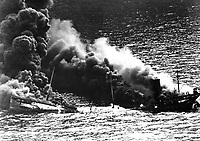 Allied tanker torpedoed in Atlantic Ocean by German submarine.  Ship crumbling amidship under heat of fire, settles toward bottom of ocean.  1942.  (Navy)<br /> Exact Date Shot Unknown<br /> NARA FILE #:  080-G-43376<br /> WAR & CONFLICT BOOK #:  1316