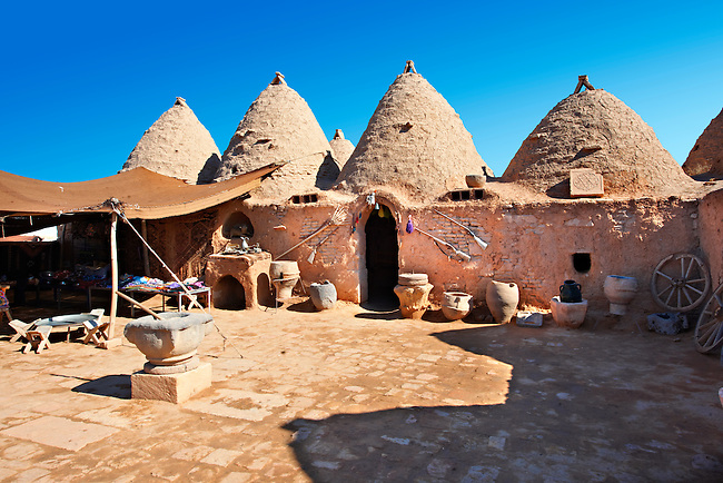 """Pictures of the beehive adobe buildings of Harran, south west Anatolia, Turkey.  Harran was a major ancient city in Upper Mesopotamia whose site is near the modern village of Altınbaşak, Turkey, 24 miles (44 kilometers) southeast of Şanlıurfa. The location is in a district of Şanlıurfa Province that is also named """"Harran"""". Harran is famous for its traditional 'beehive' adobe houses, constructed entirely without wood. The design of these makes them cool inside. 22"""