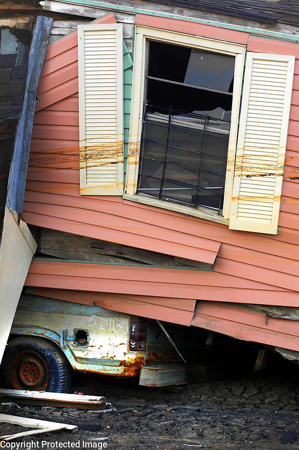 A house stands on top of a truck after floating away in the Lower Ninth Ward after Hurricane Katrina, New Orleans, Dec. 23, 2005.