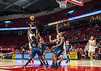 COLLEGE PARK, MD - NOVEMBER 20: Ashley Owusu #15 of Maryland lobs in a shot during a game between George Washington University and University of Maryland at Xfinity Center on November 20, 2019 in College Park, Maryland.