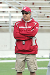 Washington State head football coach, Mike Leach, watches his squad scrimmage during spring practice at Martin Stadium on the Washington State University campus in Pullman, Washington, on April 7, 2012.