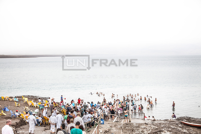 Crowd on a beach of the Dead Sea. People come from all over the places for the renowned health effects and the hyper-saline buoyancy.