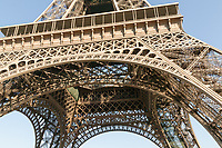 Structural detail under the Eiffel Tower showing the complex iron lattice work in Paris, France.