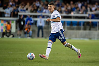 SAN JOSE, CA - AUGUST 13: Ranko Veselinovic #4 of the Vancouver Whitecaps dribbles the ball during a game between San Jose Earthquakes and Vancouver Whitecaps at PayPal Park on August 13, 2021 in San Jose, California.