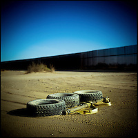 The Border Patrol for the Mexico-California border drags tyres behind their trucks in order to smooth the ground around the fence making it much easier to recognize and track new footprints of illegal immigrants coming into the USA.