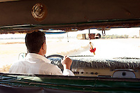 Local man driving through the Siwa Oasis in the Matruh Governorate, Egypt