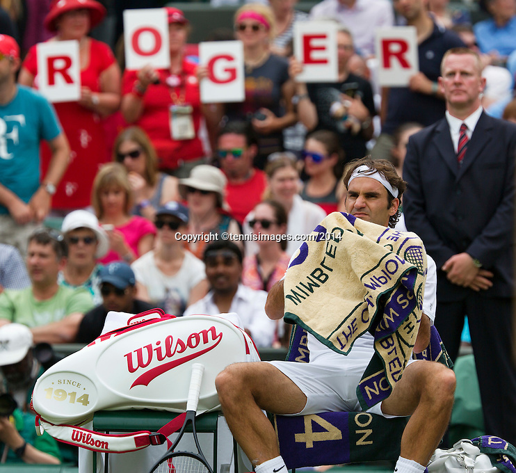 England, London, 24.06.2014. Tennis, Wimbledon, AELTC, Roger Federer (SUI) with fans behind him<br /> Photo: Tennisimages/Henk Koster