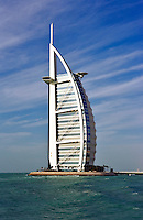 Burj al Arab Hotel, an icon of Dubai built in the shape of the sail of a dhow, stands on an artificial island just off Jumeirah Beach.   Dubai. United Arab Emirates.  Architects W.S. Atkins