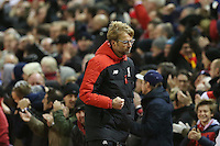 Liverpool Manager Jurgen Klopp pumps his fist in celebration as James Milner scores from the penalty spot during the Barclays Premier League Match between Liverpool and Swansea City played at Anfield, Liverpool on 29th November 2015