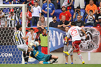 Connor Chinn (25) of the New York Red Bulls beats goalkeeper Alex Manninger (13) of Juventus F. C. to score in the 55th minute. The New York Red Bulls defeated Juventus F. C. 3-1 during a friendly at Red Bull Arena in Harrison, NJ, on May 23, 2010.