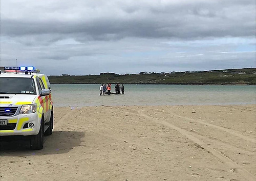 Cleggan Coast Guard and veterinarians attend the collapsed horse on Omey Island