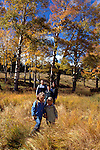 Family of five hiking in fall-colored meadow, Rocky Mtn Nat'l Park, CO