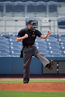 Home plate umpire Nathan Diederich calls strike three during a Florida Instructional League game between the Baltimore Orioles and the Tampa Bay Rays on October 1, 2018 at the Charlotte Sports Park in Port Charlotte, Florida.  (Mike Janes/Four Seam Images)