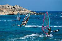 """- Naxos island (Cyclades) windsurfers profits of the """"Meltemi""""  wind near cape Mikri Vigla ..- isola di Naxos (Cicladi) surfisti profittano del vento """"Meltemi"""" presso la punta di Mikri Vigla."""