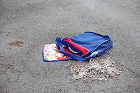 Pictured: A discarded school bag outside the house in the Alltwen area of Pontardawe, south Wales where a four year old boy died in a fire. Wednesday 27 July 2016<br /> Re: A four-year-old boy has died following a fire at a house in Neath Port Talbot.<br /> Fire crews were called to the property in Lon Tanyrallt, Alltwen, near Pontardawe, at 1.40am on Wednesday.<br /> They rescued the boy from an upstairs bedroom in the two-storey semi-detached house but he died at the scene.<br /> A three-year-old boy was also rescued and take to hospital along with his sister, six, and mother who had both managed to escape the blaze.<br /> They were all suffering from suspected smoke inhalation.<br /> Mid and West Wales Fire and Rescue Service said the woman, who is believed to be in her 20s, called for help and neighbours tried to get in to help the stranded children.
