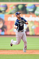 Corpus Christi Hooks shortstop Jiovanni Mier (5) throws to first during a game against the NW Arkansas Naturals on May 26, 2014 at Arvest Ballpark in Springdale, Arkansas.  NW Arkansas defeated Corpus Christi 5-3.  (Mike Janes/Four Seam Images)