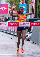 4th October 2020, London, England; 2020 London Marathon; Brigid Kosgei (KEN) celebrates as she crosses the finish line to win the Elite Women's Race as part of the historic elite-only Virgin Money London Marathon taking place on a closed-loop circuit around St James's Park in central London on Sunday 4 October 2020.