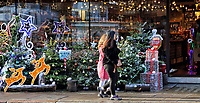 Hedonism Wines shop front full of christmas trees and colourful festive decorations. London on December 19th 2020<br /> <br /> Photo by Keith Mayhew
