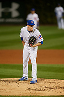 Chicago Cubs pitcher Kyle Hendricks (28) looks in for the sign in the fifth inning during Game 3 of the Major League Baseball World Series against the Cleveland Indians on October 28, 2016 at Wrigley Field in Chicago, Illinois.  (Mike Janes/Four Seam Images)