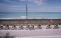 Team Mitchelton-Scott riding in close formation in the peloton next to the Adriatic Sea<br /> <br /> Stage 8: Tortoreto Lido to Pesaro (239km)<br /> 102nd Giro d'Italia 2019<br /> <br /> ©kramon