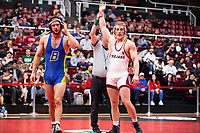 STANFORD, CA - March 7, 2020: Josh Annis of Cal State Bakersfield and Dylan Johnson of Little Rock during the 2020 Pac-12 Wrestling Championships at Maples Pavilion.