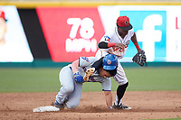 Samad Taylor (1) of the Lansing Lugnuts lands on the neck of Christian Donahue (5) of the South Bend Cubs after jumping for a high throw at second base at Cooley Law School Stadium on June 15, 2018 in Lansing, Michigan. The Lugnuts defeated the Cubs 6-4.  (Brian Westerholt/Four Seam Images)