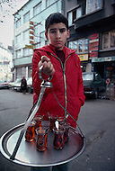 December 1978, Istanbul, Turkey. This child is employed as a tea vendor in the streets of Istanbul. - Child labor as seen around the world between 1979 and 1980 - Photographer Jean Pierre Laffont, touched by the suffering of child workers, chronicled their plight in 12 countries over the course of one year.  Laffont was awarded The World Press Award and Madeline Ross Award among many others for his work.