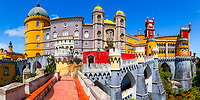 Amazing panoramic view of the famous, colorful Pena Palace, UNESCO World Heritage site, under a blue sky, without tourists, in Cintra, Portugal