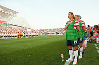 Meghan Klingenberg (14) and Heather Mitts (2) during the playing of the national anthem. The United States (USA) women defeated China PR (CHN) 4-1 during an international friendly at PPL Park in Chester, PA, on May 27, 2012.