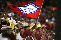 An Arkansas fan waves a flag, Saturday, June 5, 2021 during the sixth inning in the second game of the NCAA Fayetteville Regional at Baum-Walker Stadium in Fayetteville. Check out nwaonline.com/210606Daily/ for today's photo gallery. <br /> (NWA Democrat-Gazette/Charlie Kaijo)