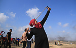 Palestinian protesters clash with Israeli security forces during tents protest where Palestinians demanding the right to return to their homeland, at the Israel-Gaza border, in the center of Gaza Strip, on May 11, 2018. Photo by Mahmoud Khattab