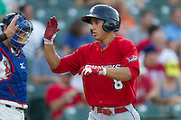 Oklahoma City RedHawks outfielder George Springer (8) is greeted at home after hitting his second home run of the game in the Pacific Coast League baseball game against the Round Rock Express on July 9, 2013 at the Dell Diamond in Round Rock, Texas. Round Rock defeated Oklahoma City 11-8. (Andrew Woolley/Four Seam Images)