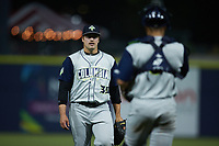 Columbia Fireflies relief pitcher Nathan Webb (35) walks towards catcher Omar Hernandez (6) after getting the final out in the game against the Kannapolis Cannon Ballers at Atrium Health Ballpark on May 20, 2021 in Kannapolis, North Carolina. (Brian Westerholt/Four Seam Images)