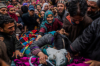 HIRPORA, SHOPIAN DISTRICT, INDIAN ADMINISTERED KASHMIR, INDIA  - APRIL 25, 2014: Sumaira Wani, 25, wife of Zia-Ul-Haq, 29, reaches for one last embrace as she mourns by the body of her husband, during his funeral on April 25, 2014 in the village of Hirpora, approximately 60km's south of Srinagar, Shopian District, Indian administered Kashmir. Zia, a Kashmiri primary school teacher and an Indian poll official was killed soon after voting for the ongoing general elections, when suspected rebels fatally shot him and wounded four others in an attack on a bus in the Indian-controlled portion of Kashmir. Voter turnout was extremely low across the district, with voting being boycotted in villages with numerous polling stations not even registering one vote. <br /> <br /> Daniel Berehulak for The New York Times