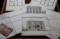 Architectural elevations and letters displayed on a table