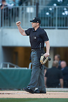 Home plate umpire Richard Riley makes an out call during the International League game between the Scranton/Wilkes-Barre RailRiders \and the Charlotte Knights at BB&T BallPark on April 12, 2018 in Charlotte, North Carolina.  The RailRiders defeated the Knights 11-1.  (Brian Westerholt/Four Seam Images)