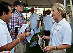 America's Best Racing's Jill Byrne talks to fans at the Racing 101 booth in The Backyard at Saratoga Race Course on Travers Stakes Day  in Saratoga Springs, New York on August 25, 2012.