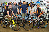 Joshua Johnson, age 13, left, Phillip Johnson, Martha Tamatea and Harlem Tamatea, age 12, receive their new bikes from Scott Guyton, centre, Kiwivelo bike presentation at Kiwivelo Cycling, Takapuna, New Zealand on Saturday, 7 November 2015. Photo: David Rowland / lintottphoto.co.nz