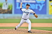 Asheville Tourists pitcher Kenny Oakley (17) delivers a pitch during a game against the Greensboro Grasshoppers at McCormick Field on April 30, 2017 in Asheville, North Carolina. The Grasshoppers defeated the Tourists 7-0. (Tony Farlow/Four Seam Images)