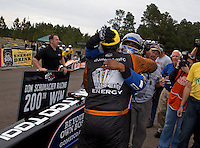 Mar. 17, 2013; Gainesville, FL, USA; NHRA winner in funny car driver Johnny Gray (near) celebrates with top fuel dragster driver Antron Brown after winning the Gatornationals at Auto-Plus Raceway at Gainesville. Mandatory Credit: Mark J. Rebilas-