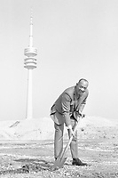 8th March 1969, Munich, Germany; Jesse OWENS, USA, athlete, sprinter, long jumper, performs the groundbreaking ceremony on the Olympic site in Munich, with the background showing the television tower
