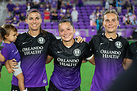 ORLANDO, FL - SEPTEMBER 11: Alex Morgan #13, Ali Riley #7 and Parker Roberts #20 of the Orlando Pride in the huddle during a game between Racing Louisville FC and Orlando Pride at Exploria Stadium on September 11, 2021 in Orlando, Florida.