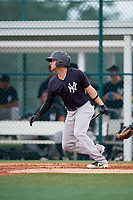 GCL Yankees East left fielder Raymundo Moreno (26) hits a single during the second game of a doubleheader against the GCL Pirates on July 31, 2018 at Pirate City Complex in Bradenton, Florida.  GCL Pirates defeated GCL Yankees East 12-4.  (Mike Janes/Four Seam Images)