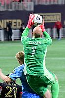 ATLANTA, GA - APRIL 27: Atlanta United goalkeeper #1 Brad Guzan wins a cross during a game between Philadelphia Union and Atlanta United FC at Mercedes-Benz Stadium on April 27, 2021 in Atlanta, Georgia.