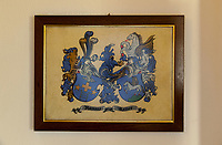 Switzerland. Canton Ticino. Sala. On the wall of the home of Elsy (Elsa) Hofer Ferrari Ramuz. The coat of arms of Ramuz and Keller families. Flying horses or winged horses are mythological and fictional creatures. Elsy Hofer Ferrari Ramuz is the niece of Charles-Ferdinand Ramuz (September 24, 1878 – May 23, 1947) who was a French-speaking Swiss writer. 14.11.2017 © 2017 Didier Ruef