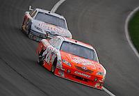Feb 22, 2009; Fontana, CA, USA; NASCAR Sprint Cup Series driver Joey Logano leads Scott Speed during the Auto Club 500 at Auto Club Speedway. Mandatory Credit: Mark J. Rebilas-