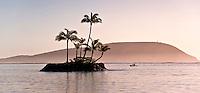 Fishing in a peaceful atmosphere at sunrise along the southeastern coast of O'ahu