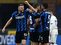 Calcio, Serie A: Inter Milano - Atalanta, Giuseppe Meazza (San Siro) stadium, in Milan, March 8, 2021.  <br /> Inter's Milan Skriniar (L) celebrates after winning 1-0 the Italian Serie A football match between Inter and Atalanta at Giuseppe Meazza (San Siro) stadium, on  March 8, 2021.  <br /> UPDATE IMAGES PRESS/Isabella Bonotto