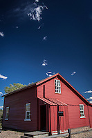 "The Bridge Tender""s House at Fort Fred Steele, near Rawlins, Wyoming.  Red clapboard house with blue sky and a few puffy clouds."
