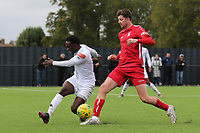 Marvin McCoy of Romford and George Sykes of Aveley during Romford vs Aveley, Pitching In Ishmian League North Division Football at Mayesbrook Park on 26th September 2020